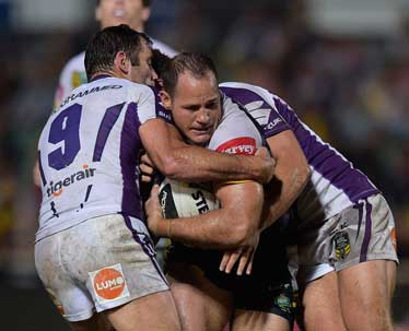 Cameron Smith lays one of his 54 tackles. Photo: Getty