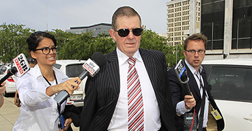 Peter Slipper enters the ACT Magistrates court in Canberra.