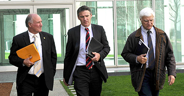 Independent MP's Tony Windsor, Rob Oakeshott and Bob Katter at Parliament House, Canberra, in 2010.