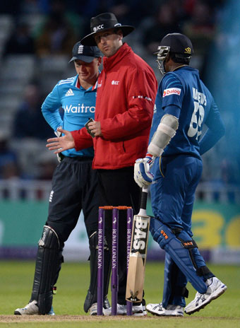 Tension mounts: Umpire Michael Gough speaks with Jos Buttler and Angelo Mathews. Photo: Getty