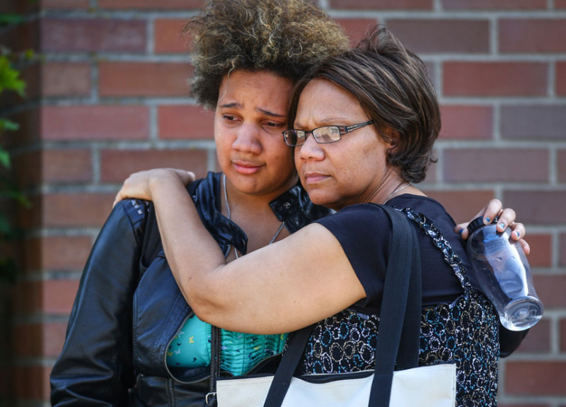 Onlookers embrace near the scene of a shooting at Seattle Pacific University