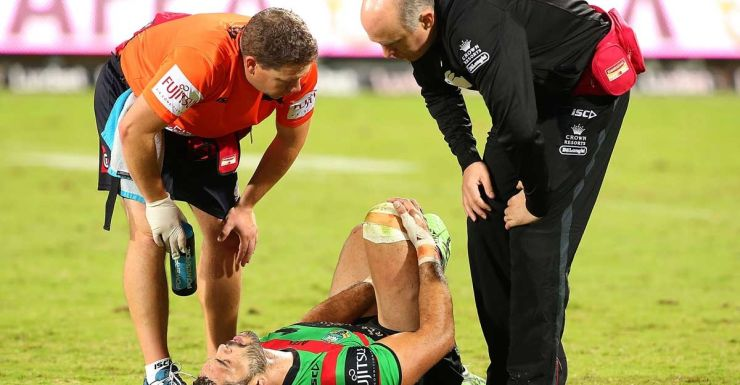 Greg Inglis goes down with a knee injury against the Warriors.