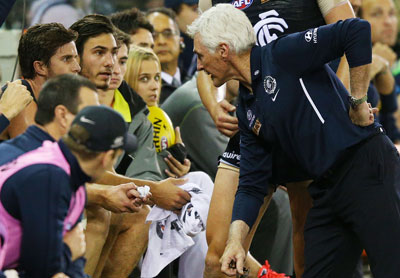 Mick Malthouse has a friendly chat with his skipper Marc Murphy. Photo: Getty