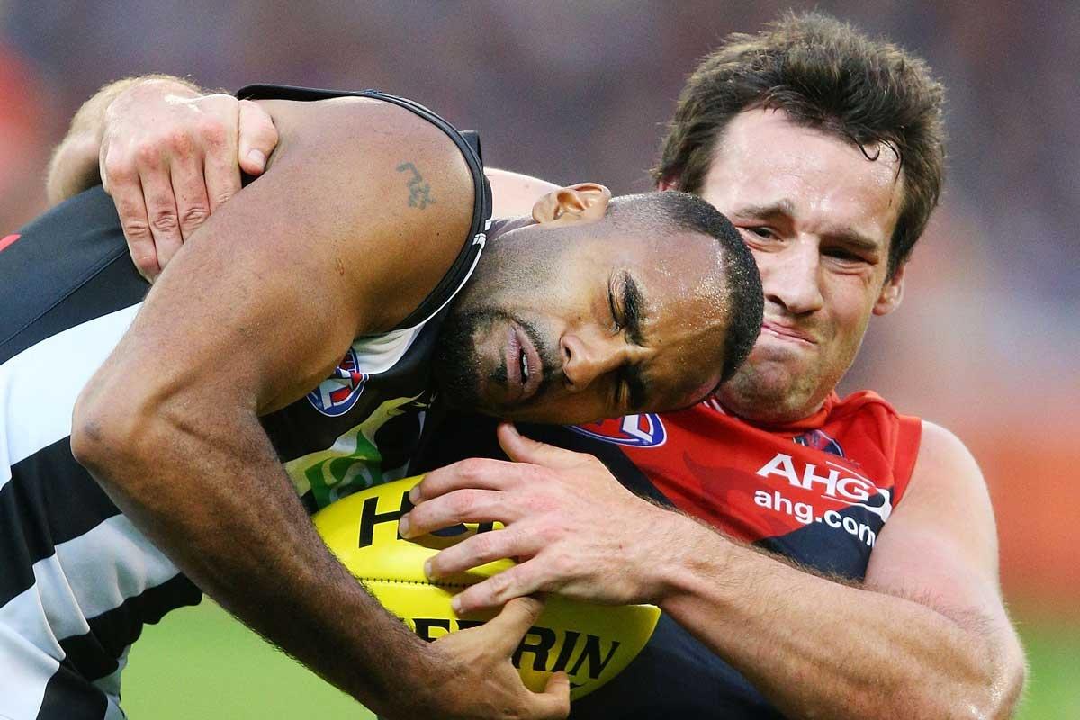 Melbourne python: Cameron Pederson tackles Heritier Lumumba.