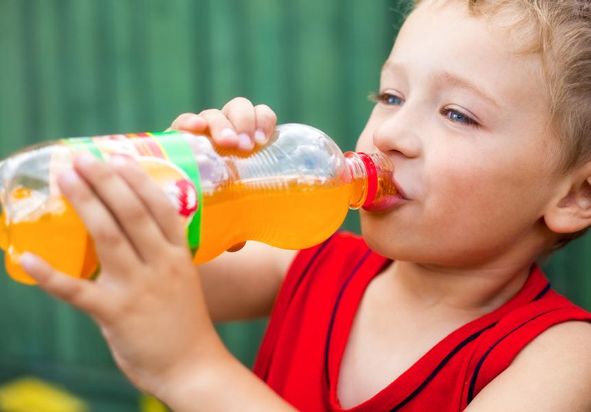 child drinking soft drink