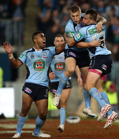 Trent Hodkinson is the centre of attention after going over for the Blues. Photo: Getty