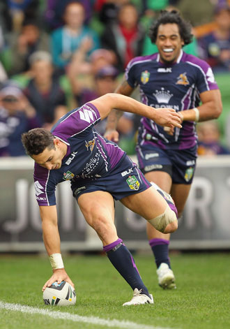 Billy Slater became the third most prolific try scorer in history. Photo: Getty