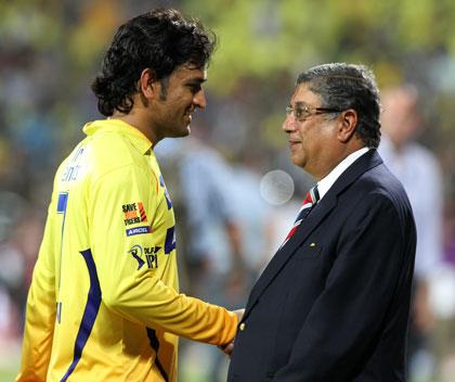 Srinivasan with Indian star M.S. Dhoni. Photo: Getty