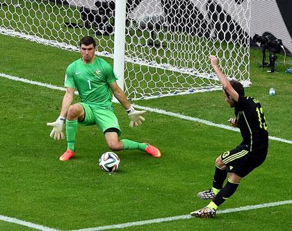 82nd minute: Juan Mata spears the ball through the legs of Mat Ryan. Photo: Getty