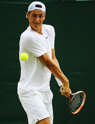Bernard Tomic lines up a backhand during his victory. Photo: Getty