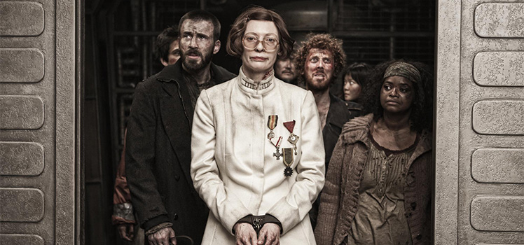 Flanked by actors Chris Evans (left) and Octavia Spencer (right), Tilda Swinton is almost unrecognisable in the sci-fi flick Snowpiercer. Photo: Supplied