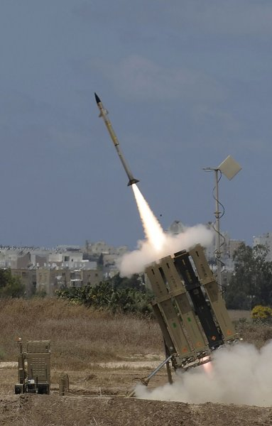 "A missile is launched by an ""Iron Dome"" battery, a short-range missile defence system designed to intercept and destroy incoming short-range rockets and artillery shells, on July 14, 2014 in the southern Israeli city of Ashdod. United Nations chief Ban Ki-moon called on Israel to scrap plans for a ground offensive, saying ""too many"" Palestinian civilians had been killed as the death toll from its punishing air campaign hit 172, with another 1,230 wounded. AFP PHOTO / DAVID BUIMOVITCH"