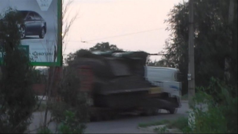 A still taken from a video made available by the Ukrainian Interior Ministry purportedly showing a truck carrying the Buk missile launcher with one of its four missiles apparently missing.