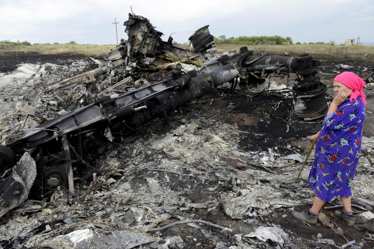 A Ukrainian woman wanders through the wreckage. Source: AAP