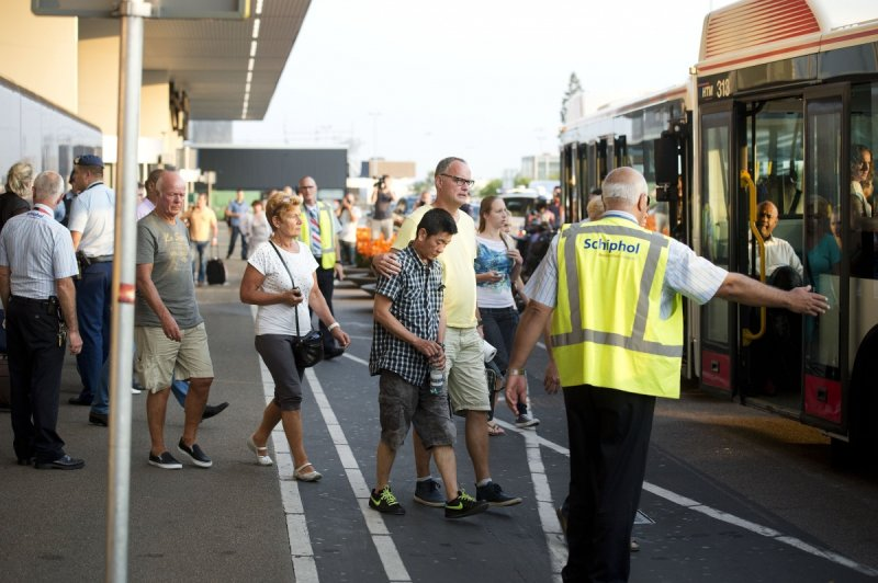 Relatives of passengers of Malaysia Airlines flight MH17 get onto a bus at Schiphol Airport near Amsterdam.