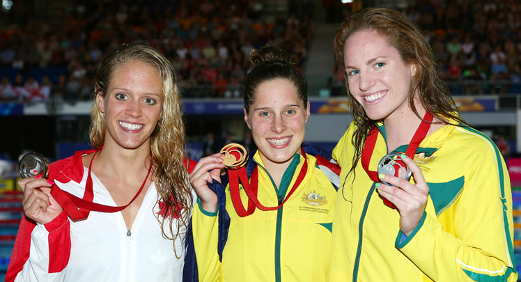 Gold medallist Belinda Hocking flanked by silver medallist Emily Seebohm (R) and bronze medallist Hilary Caldwell of Canada. Photo: Getty