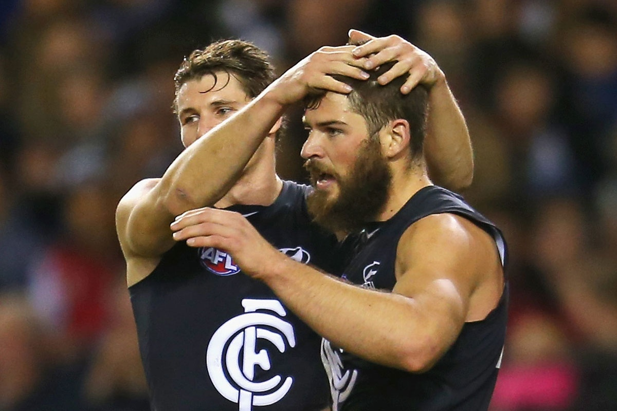 Levi Casboult (R), who booted four goals, is congratulated by Andrejs Everitt.