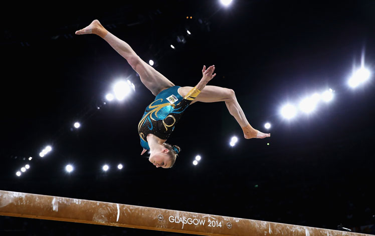 Georgia Rose Brown of Australia competes on the beam during the women's team event.