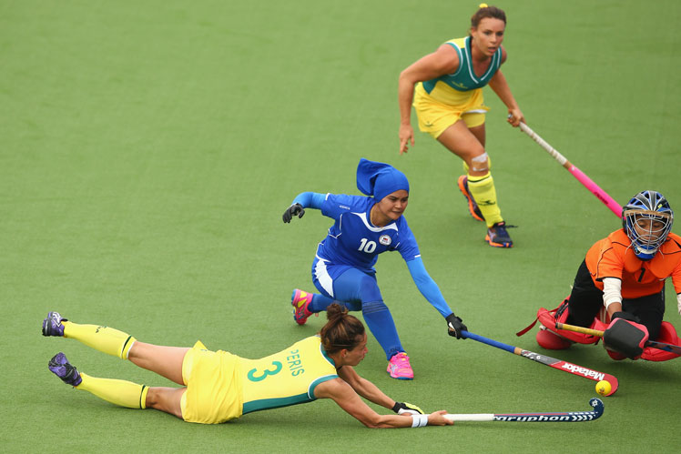 Brooke Peris of Australia dives to shoot at goal during the Hockeyroos' win over Malaysia. Photo: Getty