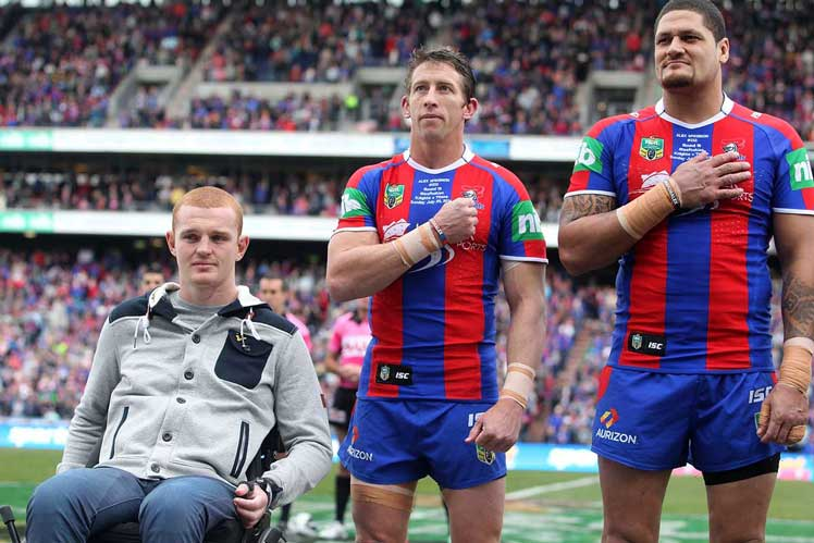 Kurt Gidley (C) and Willie Mason stand alongside McKinnon before the start of Sunday's match. Photo: Getty