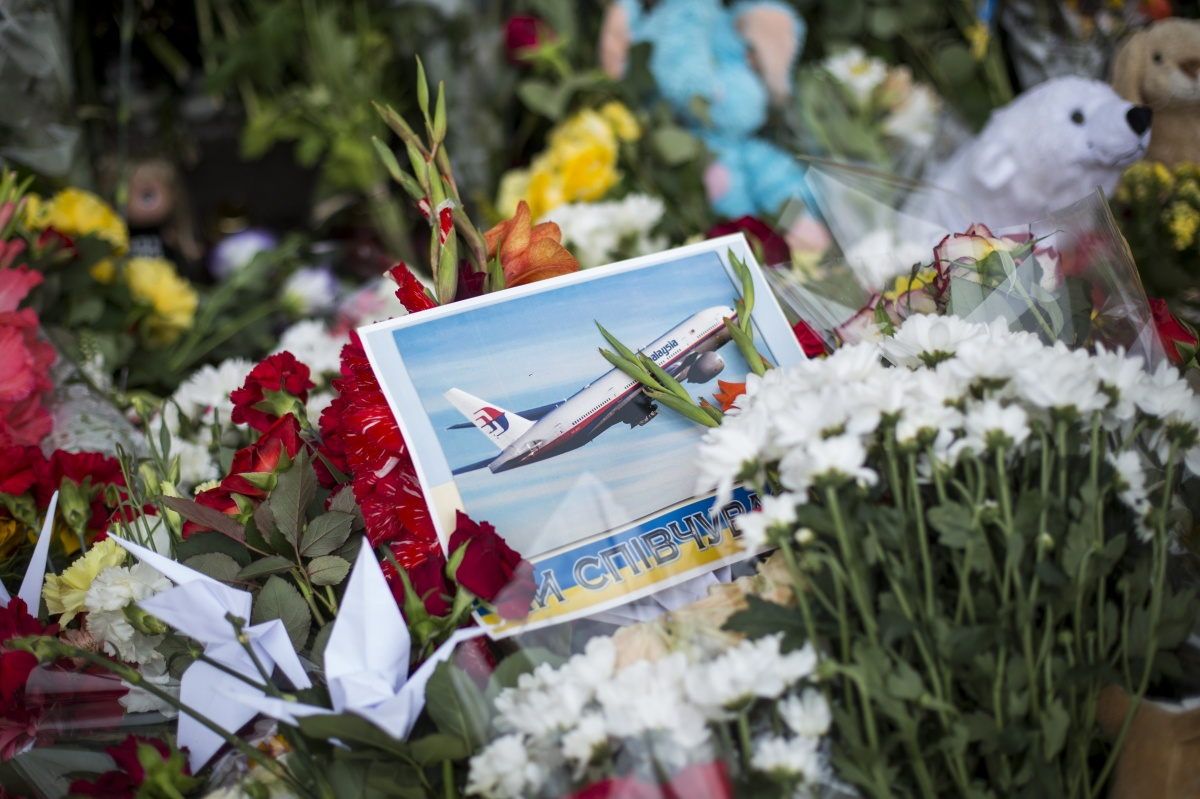 Tributes in front of the Netherlands Embassy in memory of the victims of flight MH17. Getty