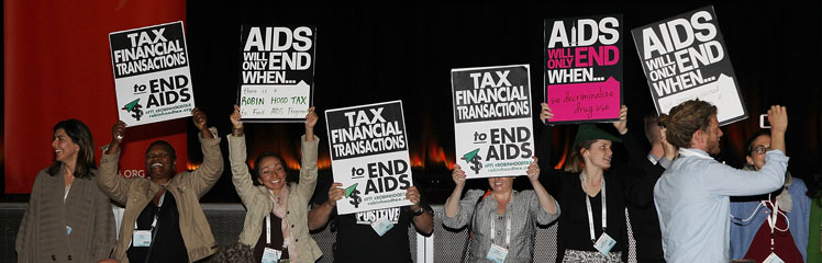 Protesters interrupt former President Bill Clinton at the AIDS conference. Photo: Getty