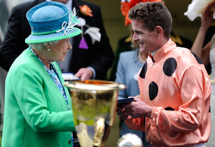 The Queen and the colonial boy, jockey Luke Nolan, after Black Caviar's win at Royal Ascot. Photo: Getty