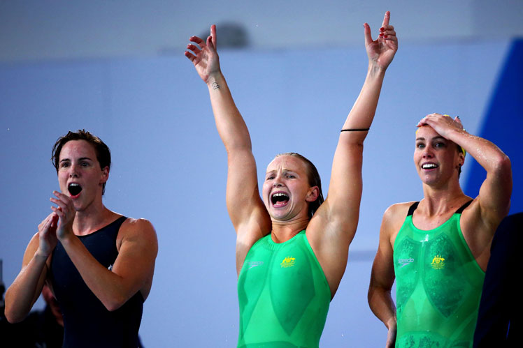 Bronte Campbell (L), Melanie Schlanger (C) and Emma McKeon cheer Cate Campbell home. Photo: Getty