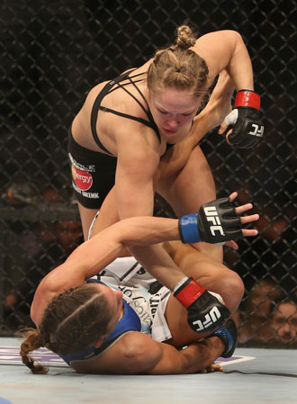Rousey goes after American Liz Carmouche. Photo: Getty