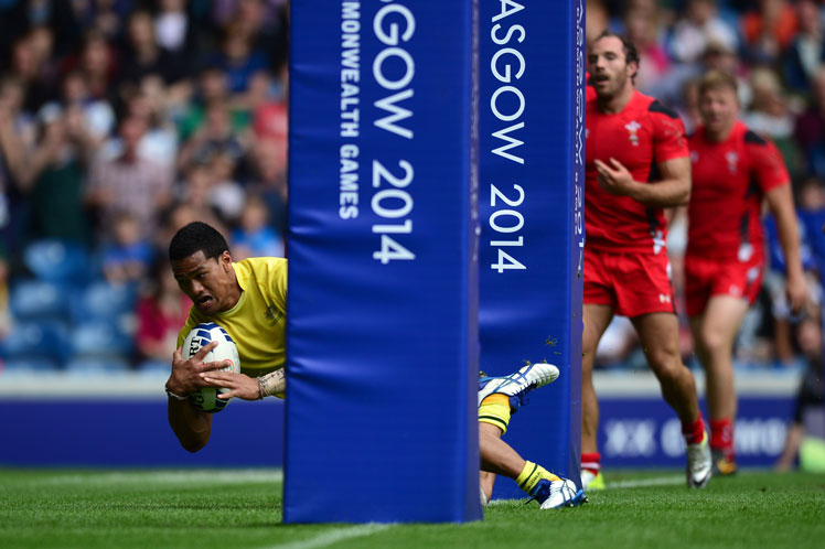 Pama Fou of Australia scores the winning try against Wales. Photo: Getty