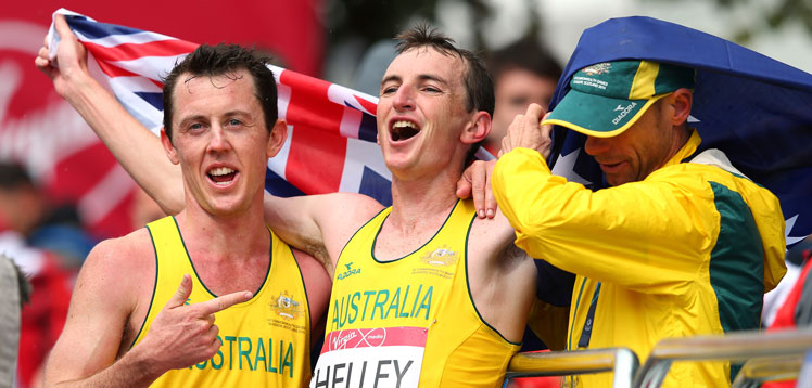 ... and celebrates with Liam Adams, who finished seventh, and chef de mission Steve Moneghetti. Photos: Getty