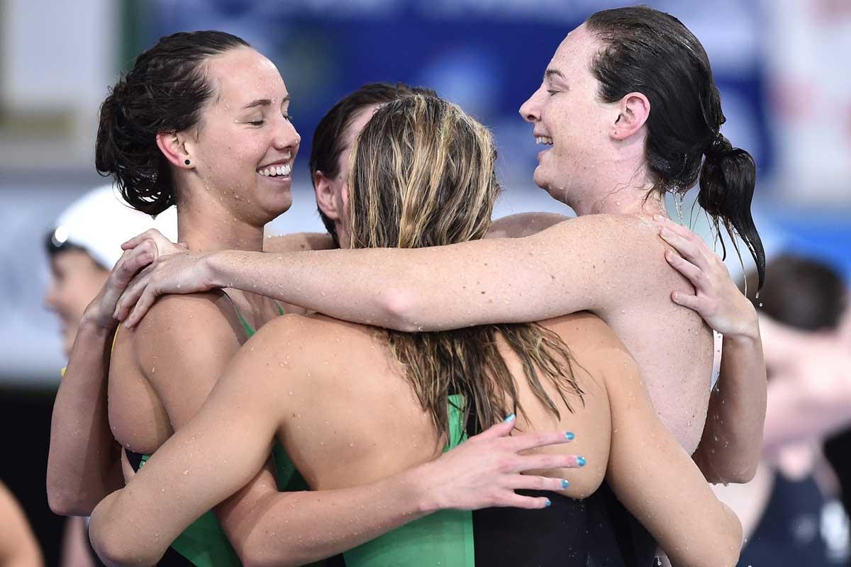 Australia's relay team celebrate their world record.