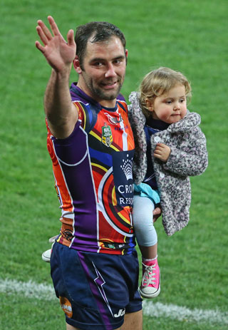 Cameron Smith and daughter thank the crowd after the Storm's victory. Photo: Getty