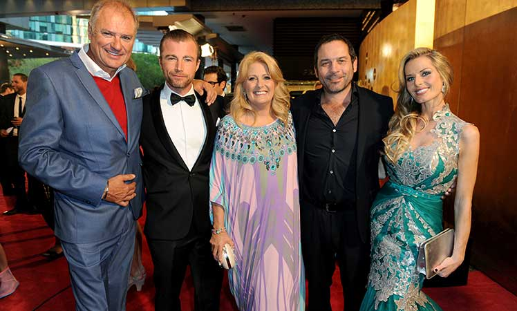 Byrne (centre) at the 2014 Logies with the cast of Fat Tony & Co.
