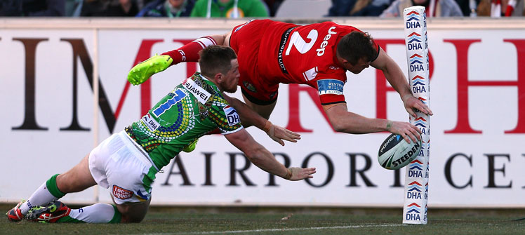Brett Morris of the Dragons scores a spectacular try against Canberra. Photo: Getty