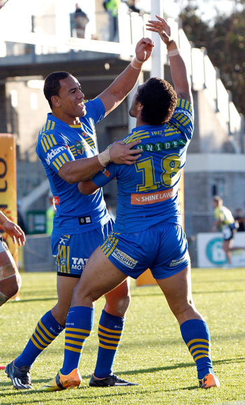 Bureta Faraimo celebrates a try with teammate Will Hopoate. Photo: Getty