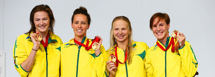 World beaters Cate Campbell, Emma McKeon, Melanie Schlanger and Bronte Campbell with the spoils of victory. Photo: Getty