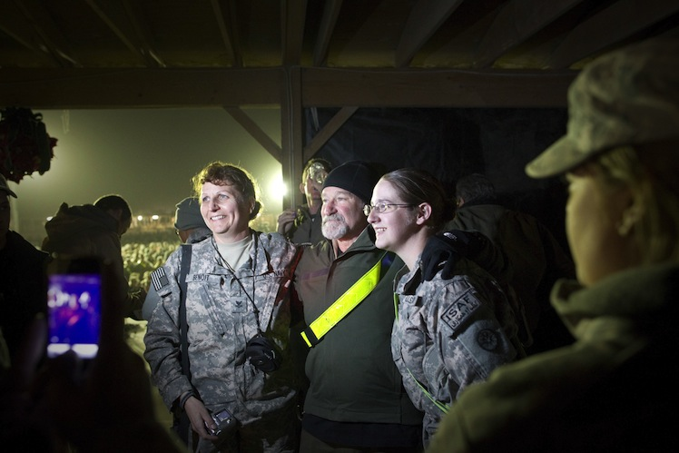Williams visiting with US troops in 2010.