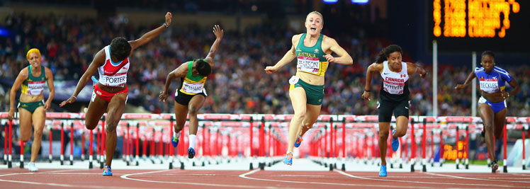 Sally Pearson crosses first in the hurdles. Photo: Getty