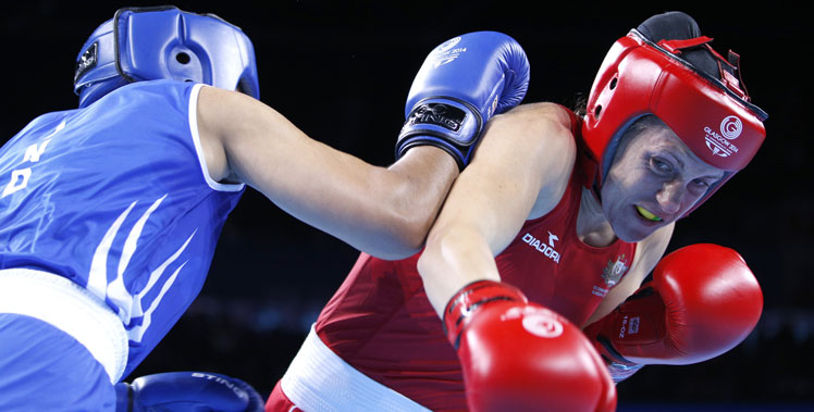 Shelley Watts (red) fights India's Laishram Devi during the women's light (57-60kg) final. Photo: Getty