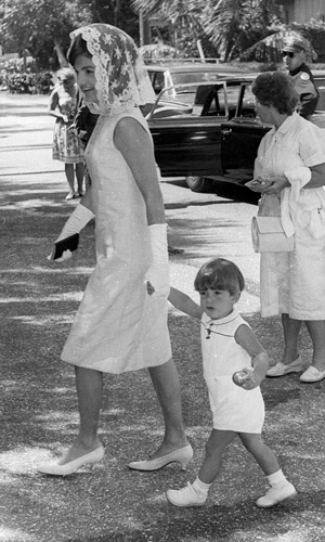 Jackie Kennedy on her way to Sunday mass in 1963, with son, John F. Kennedy Jnr. Photo: AAP