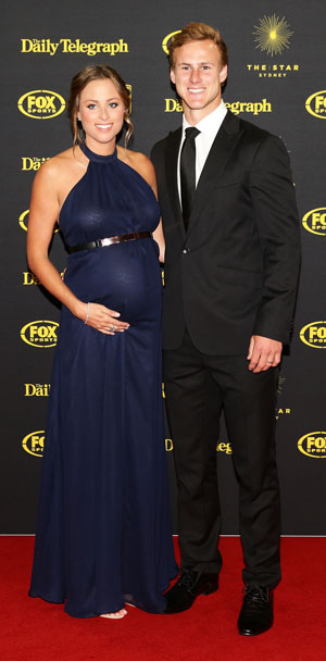 Daly Cherry-Evans, who was named best halfback, with wife Kellie. Photo: Getty