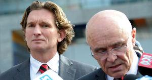 James Hird (L) outside court with Essendon chairman Paul Little.