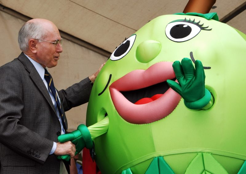 Former Prime Minister John Howard meets the Granny Smith festival mascot in his seat of Bennelong in 2007.