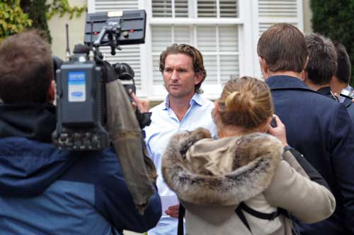 James Hird reads his statement outside his home on Thursday morning. Photo: AAP
