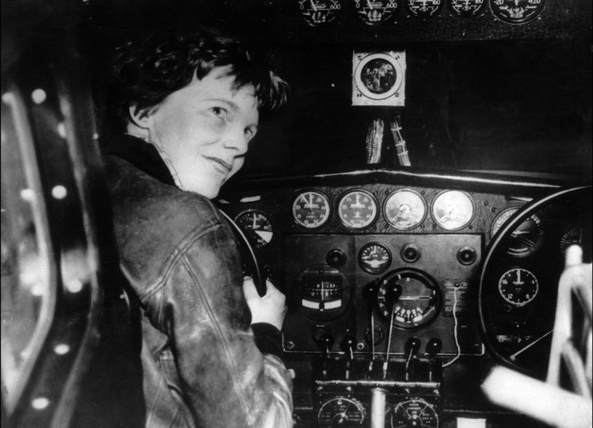 Amelia Earhart at the controls of an aircraft in France.