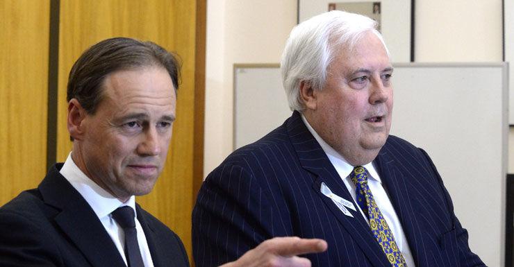 Greg Hunt (L) and Clive Palmer