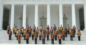 Indonesian President Joko Widodo poses for photos with members of his cabinet.