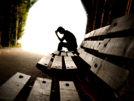 man on a bench sad