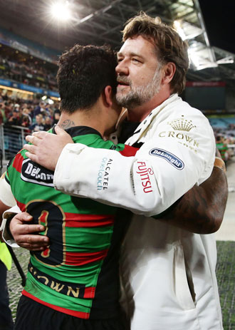 Russell Crowe embraces Issac Luke after the preliminary final. Photo: Getty